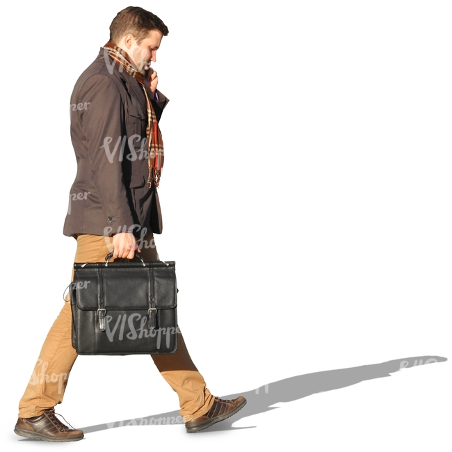 man with a suitcase walking and talking on the phone
