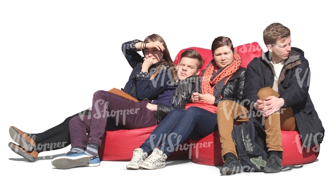 group of youngsters sitting on cushions