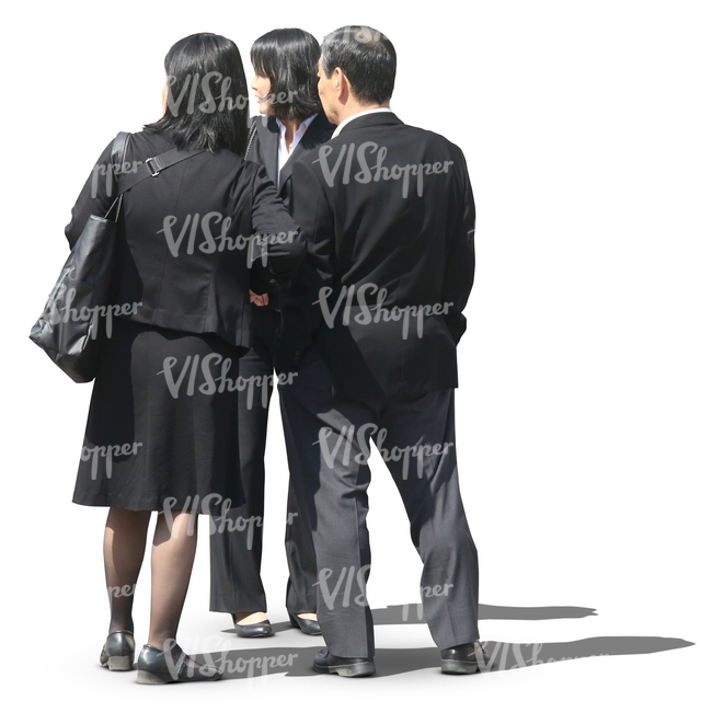 group of asian business people standing and looking at smth