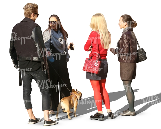 group of people and a dog standing in a circle