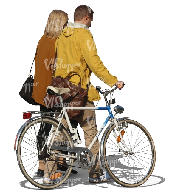 man and woman walking next to a bicycle