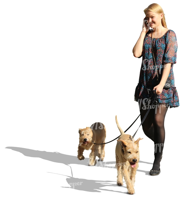 woman with two dogs talking on the phone