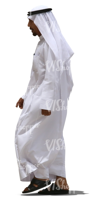 arab man in a white dishdasha walking