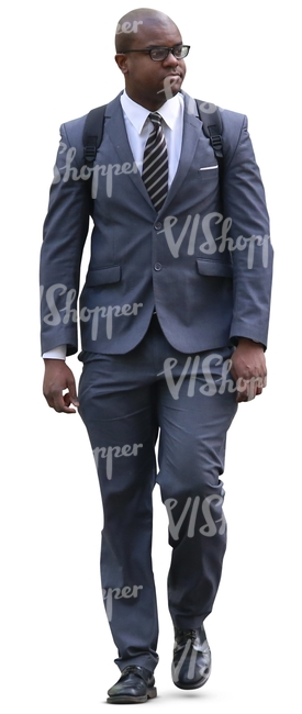 black man in a grey suit walking