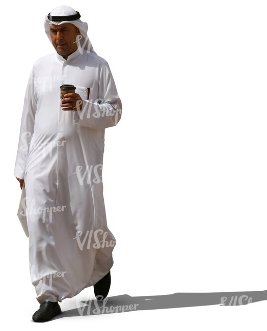 muslim man in a white thobe walking and drinking coffee