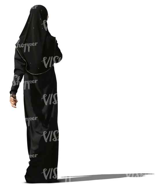 muslim woman in a black abaya walking