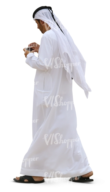 arab man walking and looking at his phone