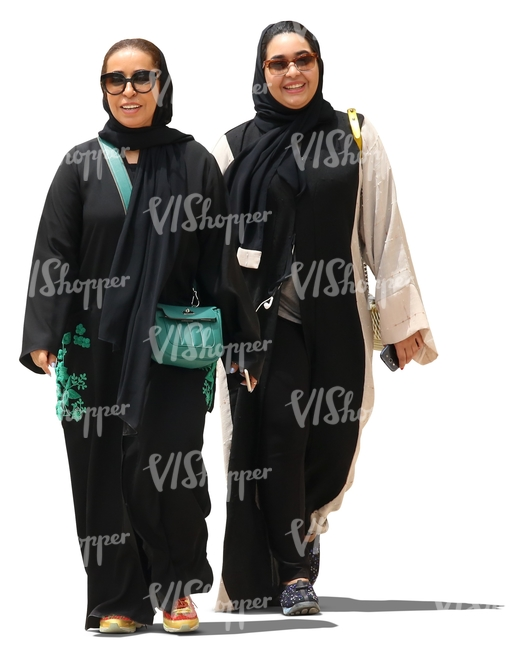 two muslim women walking and smiling