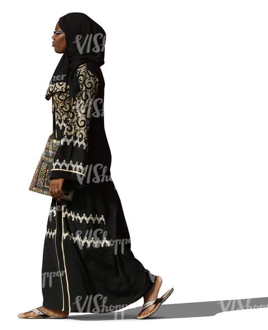 muslim woman in a decorated abaya walking
