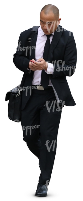 asian businessman walking while looking at his phone