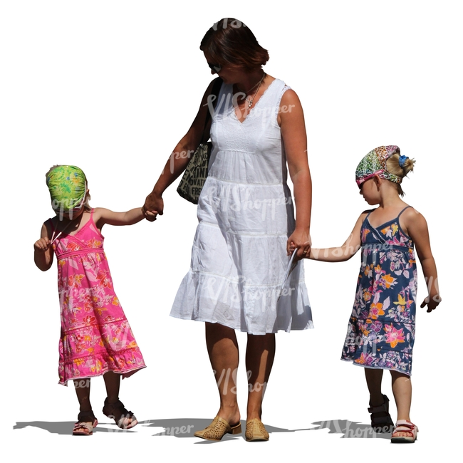 woman with two girls walking hand in hand
