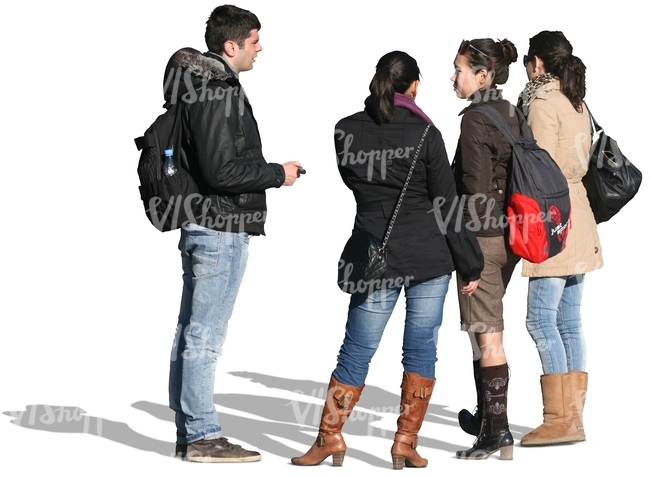 group of people in winter jackets standing together