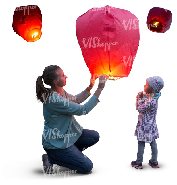 mother and daughter lighting a sky lantern