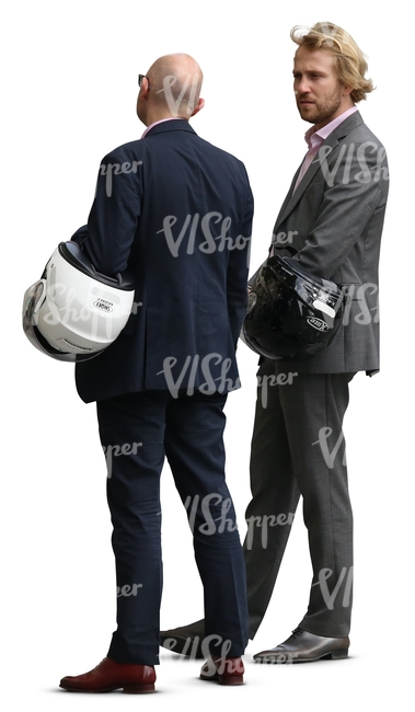 two cut out businessmen with helmets standing