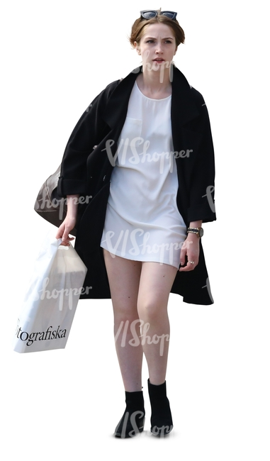 stylish woman in black and white with a shopping bag