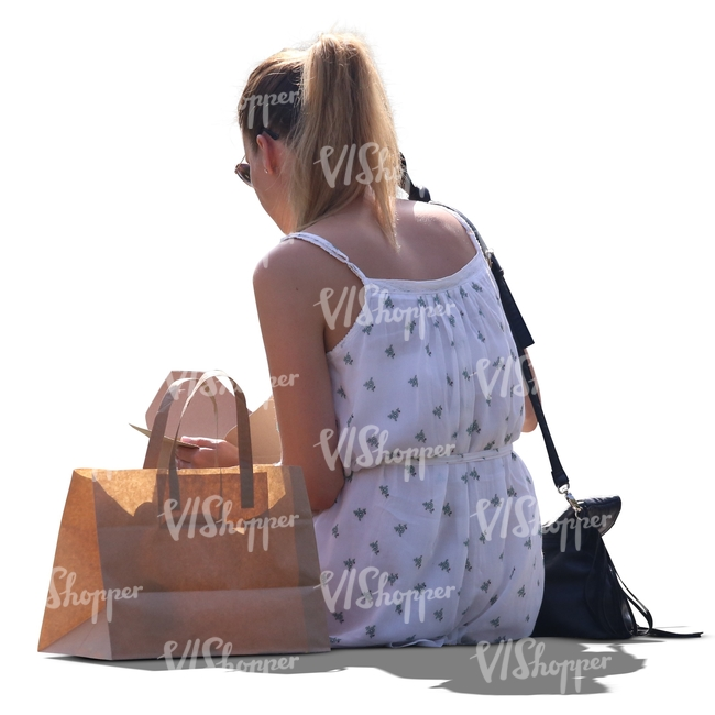 cut out backlit woman sitting and eating lunch