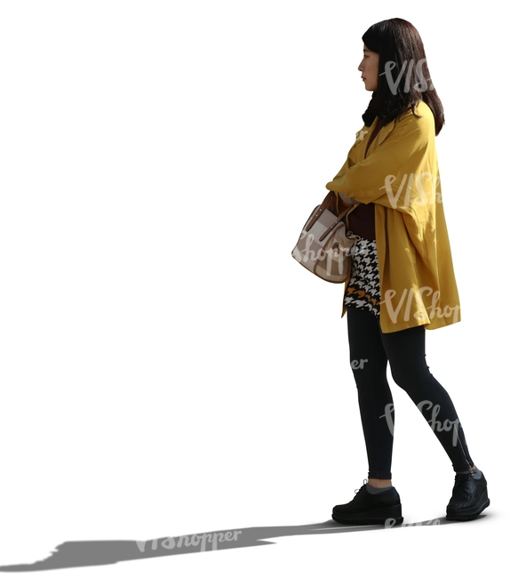 backlit asian woman standing