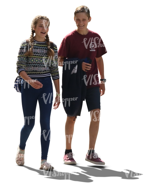 backlit teenage boy and girl walking and talking