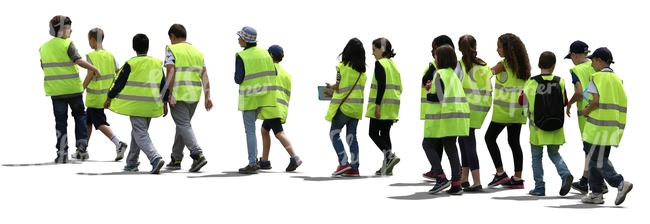 group of students wearing reflector vests walking in line