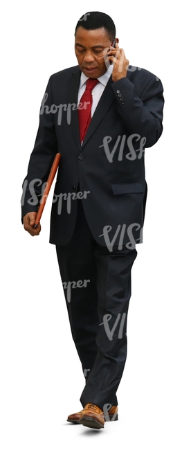 cut out black businessman walking while talking on the phone