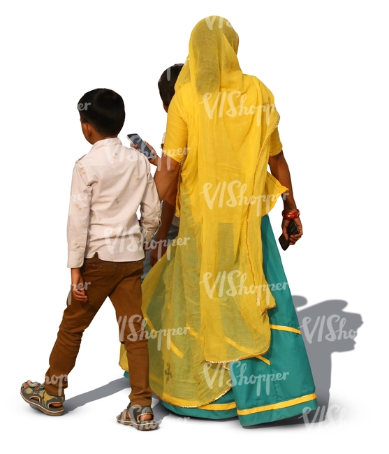 hindu woman wearing a sari walking with her two sons