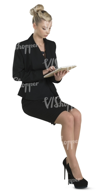 businesswoman in a black costume sitting and reading