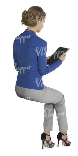 female office worker sitting and lookig at the ipad