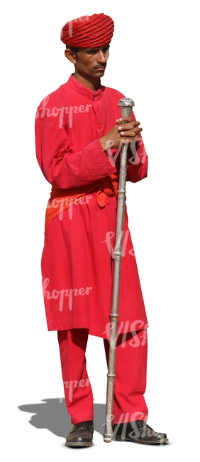 hindu man wearing a red suit and turban standing