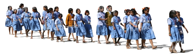group of indian schoolgirls walking in a row