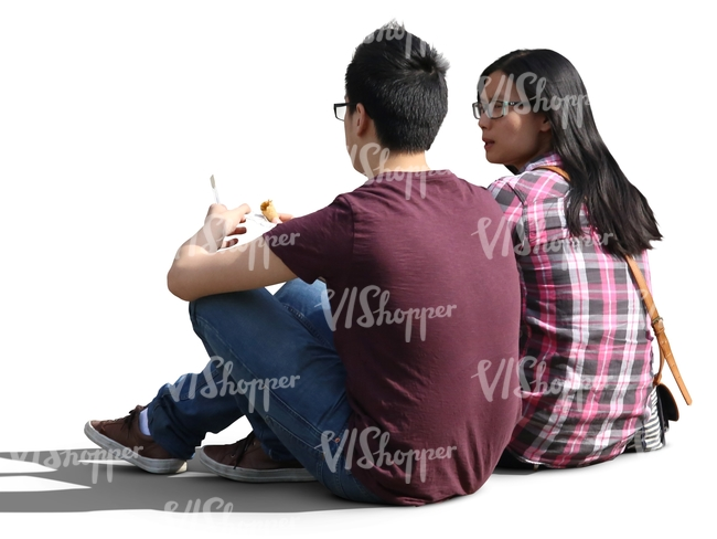 asian couple sitting on the ground