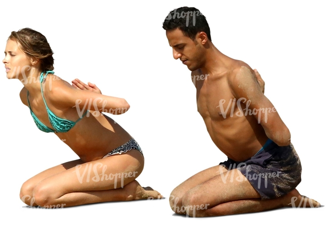 man and woman doing a yoga exercise on the beach