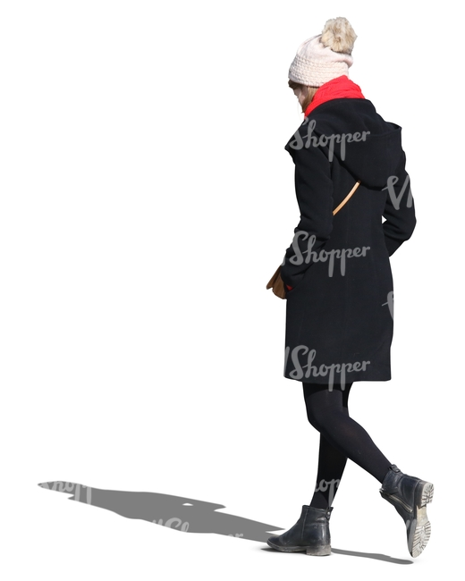 woman wearing a black coat and white hat walking