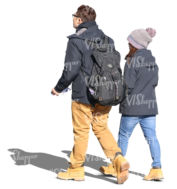 asian couple walking hand in hand in the autumn sun