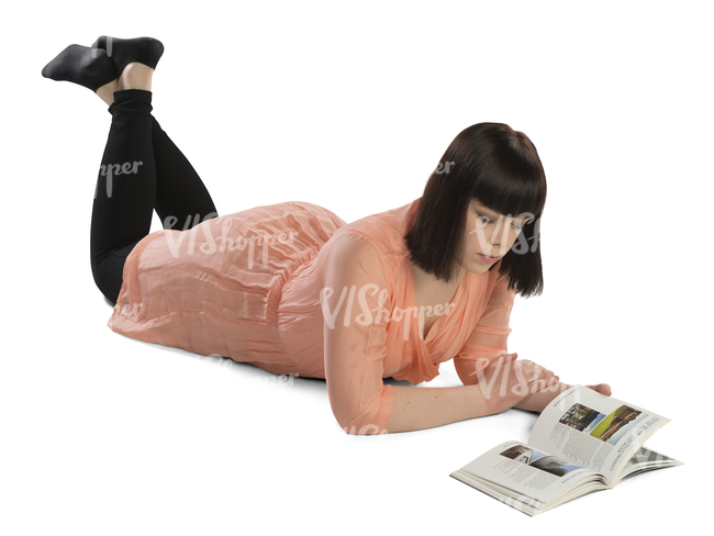 woman lying on the floor and reading a book
