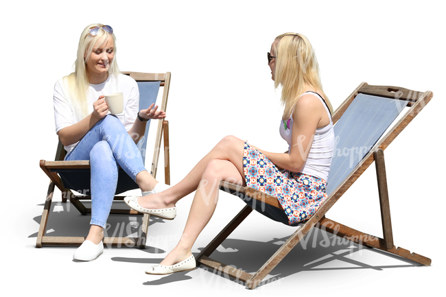 two women sitting on sling chairs and drinking coffee