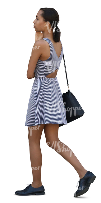 black woman in a striped mini dress walking