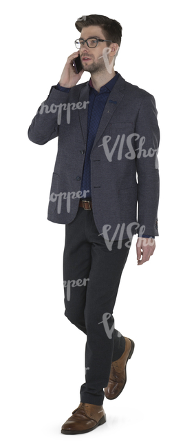 modern businessman walking and talking on the phone