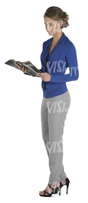 female office worker standing and looking at a magazine