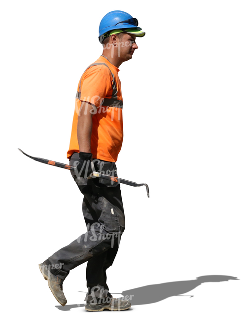 worker with a helmet walking with a crowbar in his hand