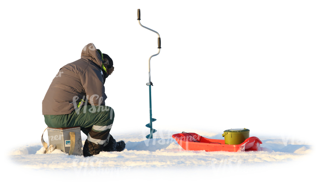 man ice fishing on a snowy lake