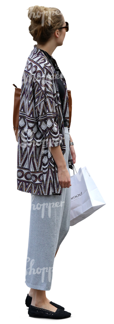 woman with a shopping bag standing in ambient light