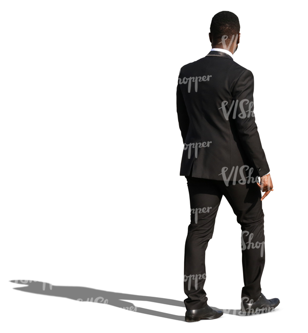african man in a black formal suit walking