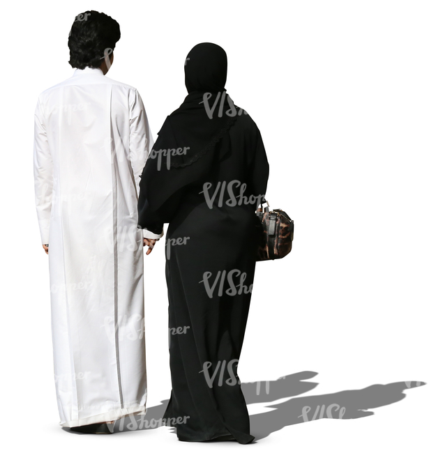 arab couple in traditional clothes walking hand in hand