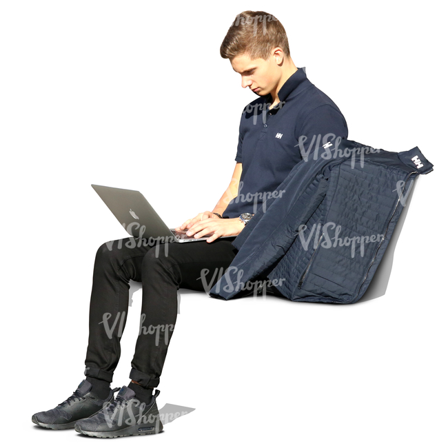 young man sitting on a bench and working on his laptop