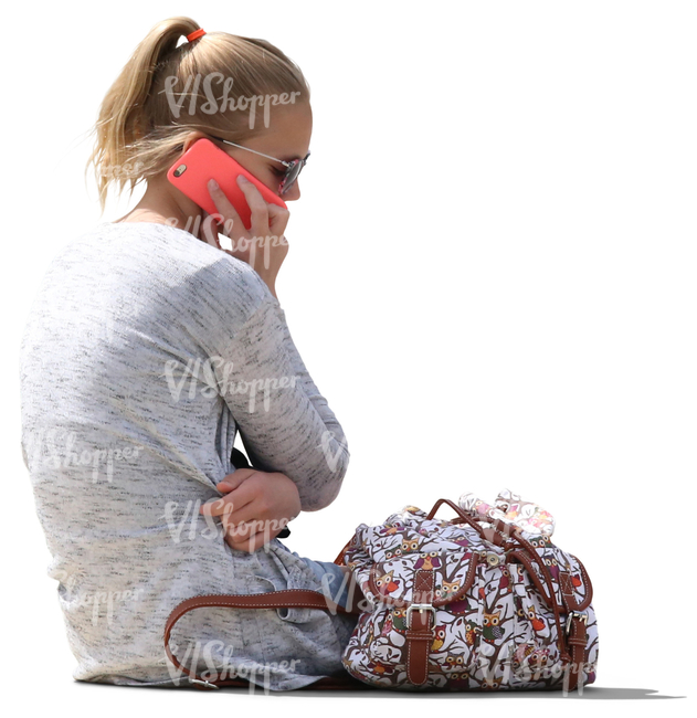 girl sitting and talking on the phone