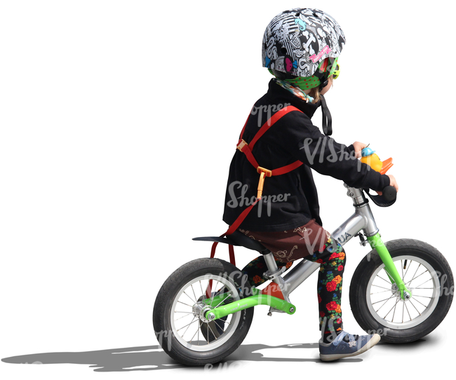 child wearing a helmet riding a likeabike