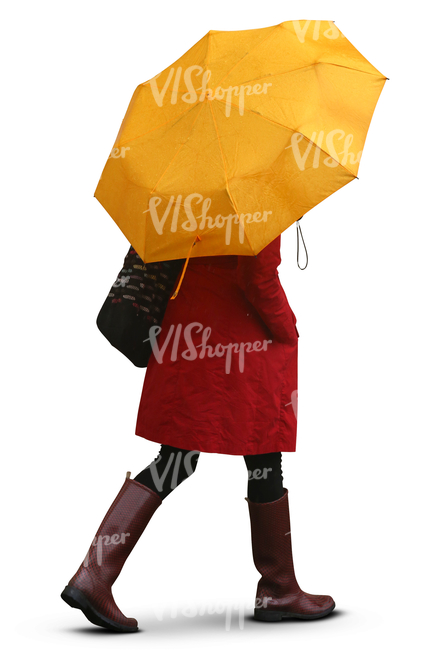 Woman With A Yellow Umbrella Walking In The Rain