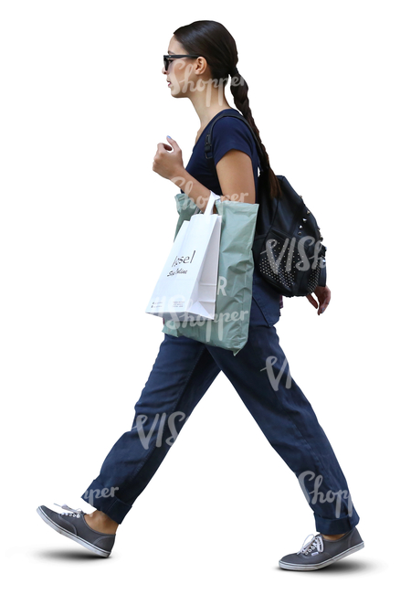 stylish woman with shopping bags walking in ambient light
