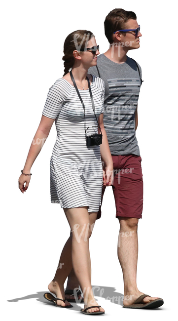 young man and woman walking hand in hand in summer