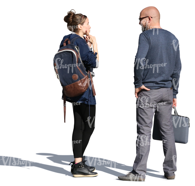 man and woman standing on the street and talking